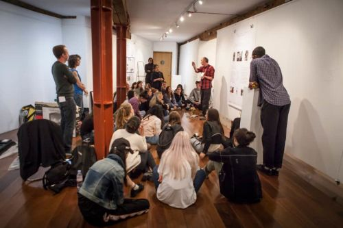 People sat down in a gallery space