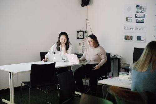 Hackathon day 2 experimentation two girls discuss ideas