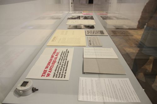A glass case filled with archival documents