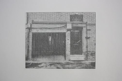 An etching of the front of a brick building