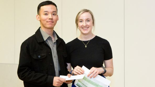 Simon Rai, winner of the 2019 Hollyport Capital Prize, receiving his award from Katy Lynch, Hollyport Capital Associate