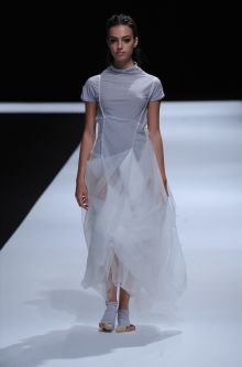 Female model wearing grey dress designed by Mengqi Lin