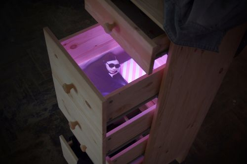 Projected video in chest of drawers by Shiye Teng.