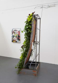 Sculptural work by Phil Sladek featuring plants and steel.