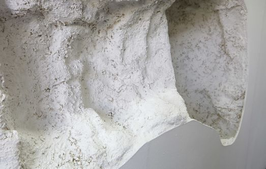 White and grey organic form sculpture by Julia Villard.