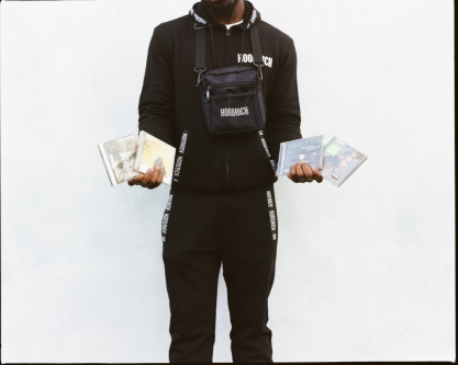 Shot of a young man holding 4 Grime music CDs
