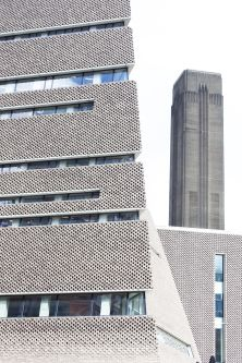 an external shot of tate modern with another building in the background
