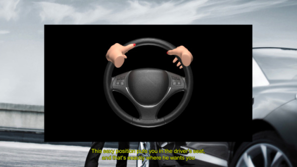 Steering wheel overlaid on background of car with female hands on the wheel.