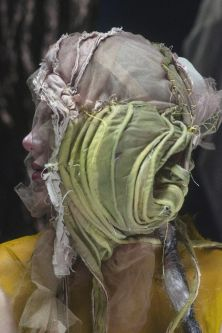 Head covered with green and transparent headpiece