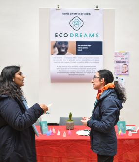 lady talking in front of ECO Dreams poster