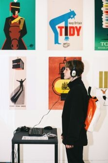 Members of the public looking at Tom Eckersley posters
