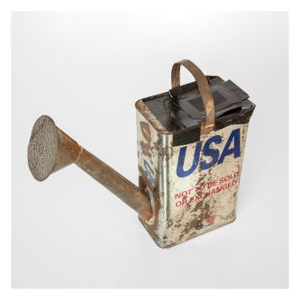 Oil can turned into a watercan, with the words USA on the side.