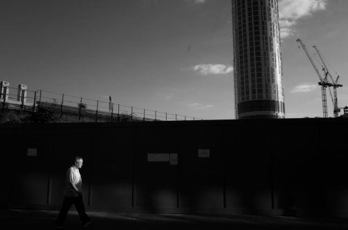 a man walking with industrial background