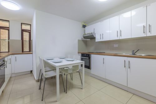 Shared kitchen example with sit down table space