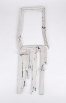 pale wash broken wood artefact with small handle