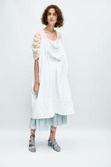 model in white loose dress garment
