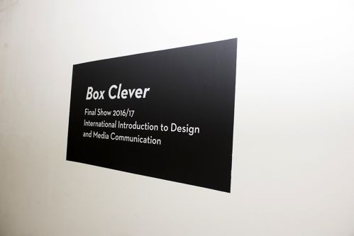 A title card for the exhibition, it is black with white text.