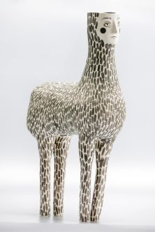 A ceramic four legged creature