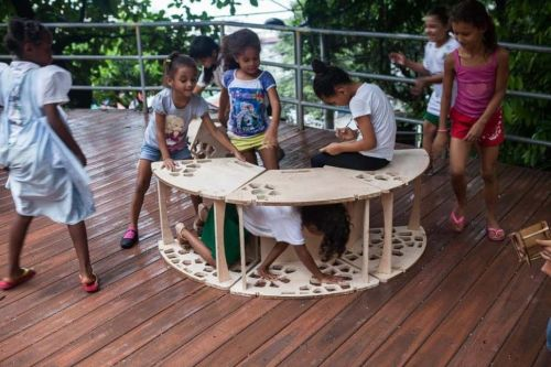 Children playing on a wooden structure