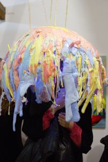 Figure standing inside brightly colour sphere