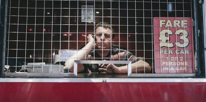 man at fairground desk