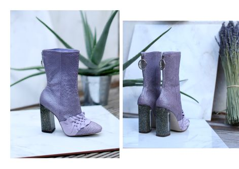 Mauve boot with plant in the background