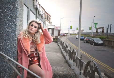 Model in urban landscape wearing clothes by Alice Bardgett.
