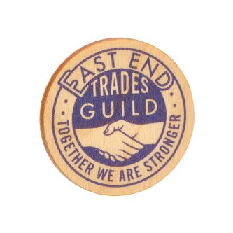 Brooch inscribed with East End Trades Guild