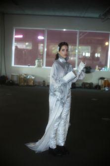 Female model in long grey silk dress