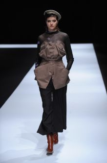 Female model wearing a two piece suit designed by Yebin Maeng