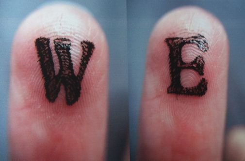 Typography on fingers.
