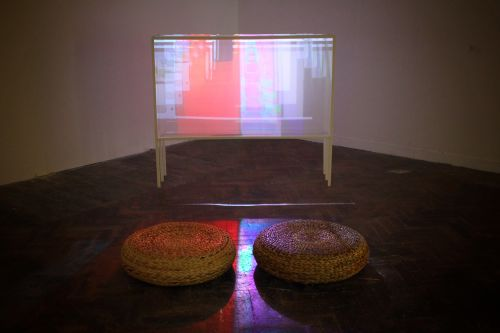 Video projection with 2 woven seats by Shiyuan Guo.