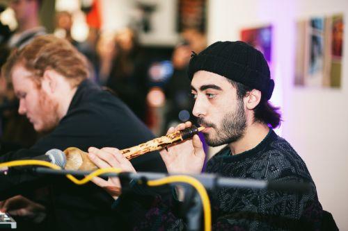 An artist playing a wind instrument