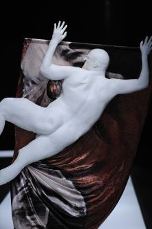 artefact sculpture of a naked man lying on a draped cloth