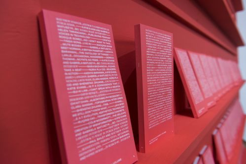 close up image of orange book shelf with orange books displayed