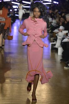 Woman walking down catwalk in pink
