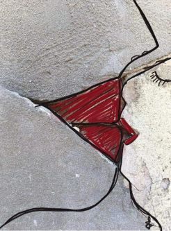 A close-up of a crack in a concrete wall which has been drawn and painted on to look like two people kissing