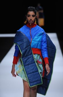 Female model wearing colourful dress made out of sleeping bags designed by Amber Kim