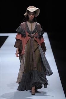 Female model wearing a multi-piece dress designed by Yilan Jia