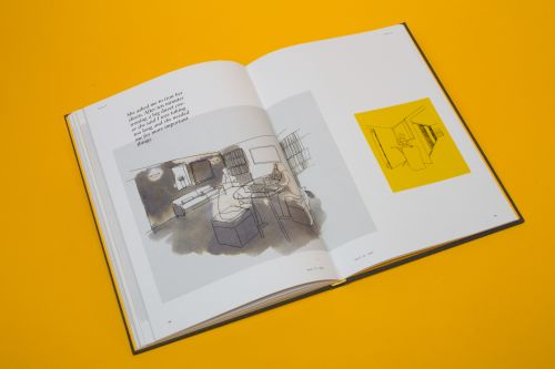 An open book on a yellow background