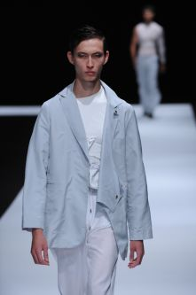 Male model with white clothing and powder blue jacket