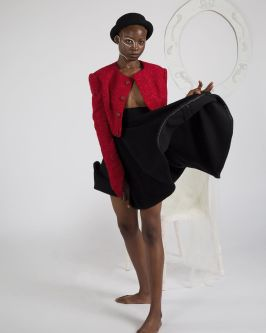Female model wearing a jacket and a skirt