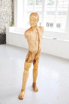 Figurative wooden sculpture by Grant Wilkinson.