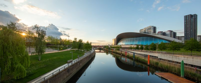 a sunset view of London Aquatics Center from the canal