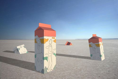 Milk cartons sitting in sand