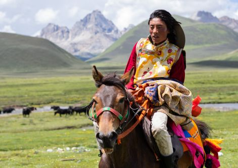 woman riding horse back in Asia