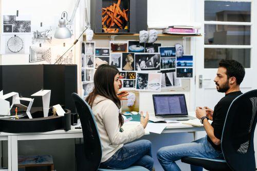 MA Theatre Design student Laura Arroyo Rocha in discussion in the Studio