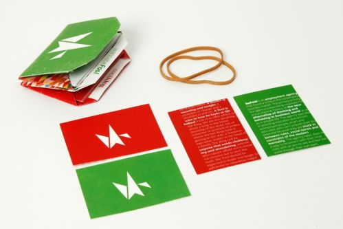 A selection of red and green branded leaflets with illustrations of white origami cranes on the front.