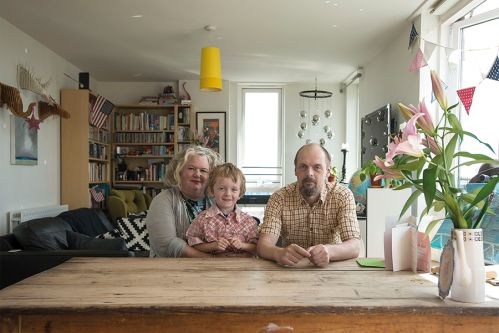 Family portrait set in a kitchen