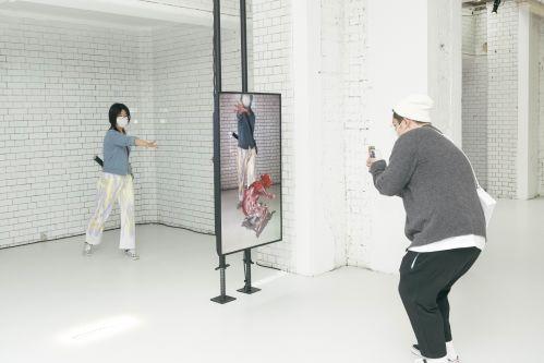 People taking photos of virtual reality